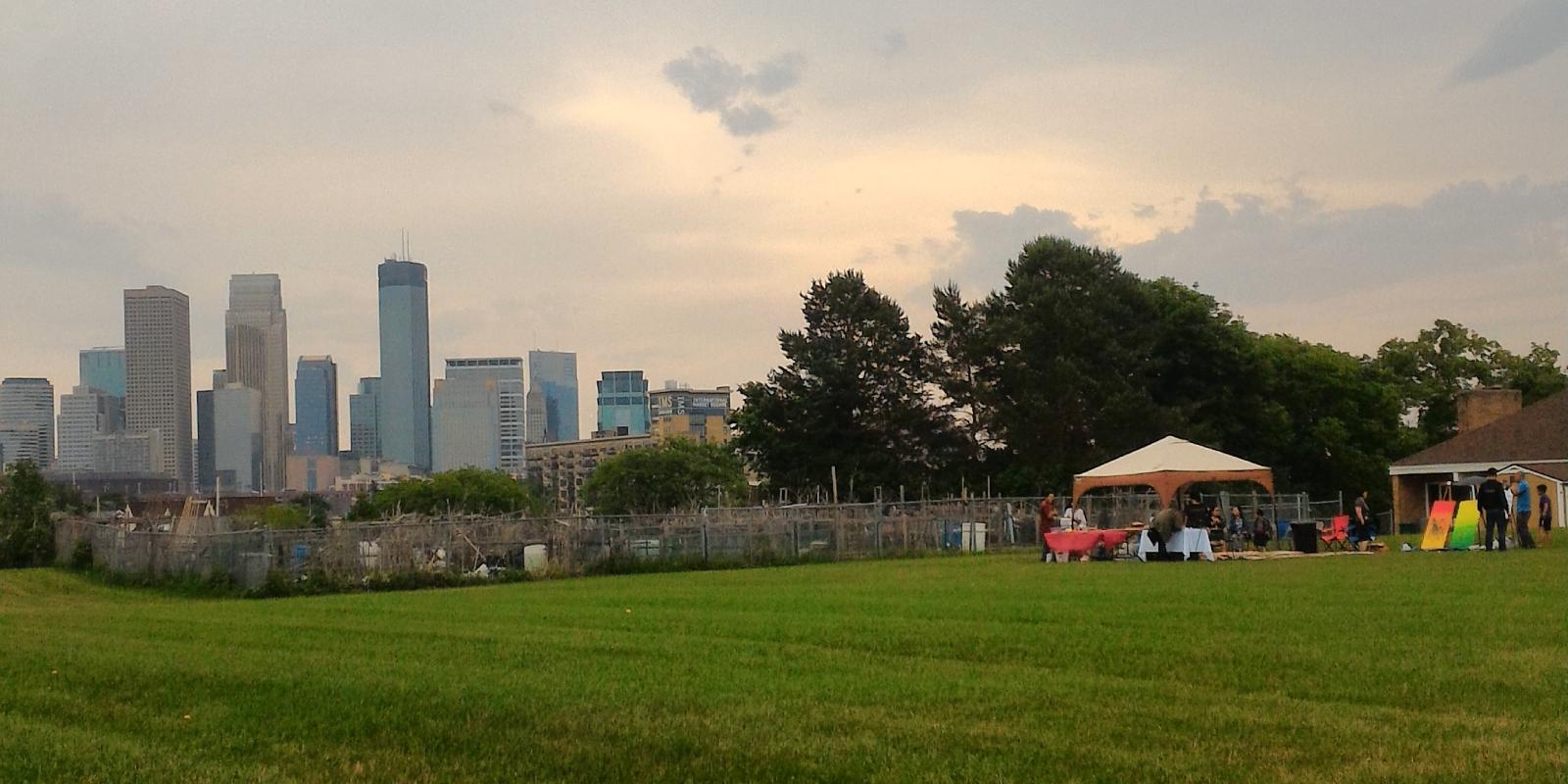 Downtown Minneapolis skyline above community garden